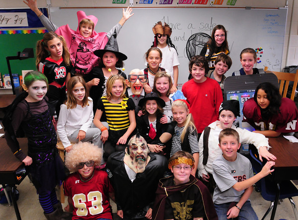 Newburyport: Molin School fifth-graders in Bob Doyle's class, pictured, did a Halloween parade at Port Rehab and brought the residents cards. Bryan Eaton/Staff Photo