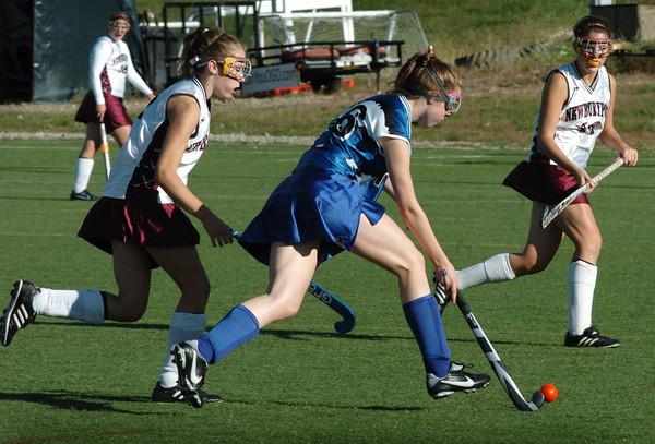 Amesbury: Georgetown's Kailey Donovan heads down field with Newburyport's Riley Hordan on her heels. Bryan Eaton/Staff Photo