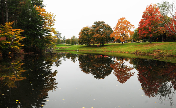 Amesbury: The glass-like pond at Amesbury Town Park sharply reflects the surrounding landscape Monday morning. Bryan Eaton/Staff Photo