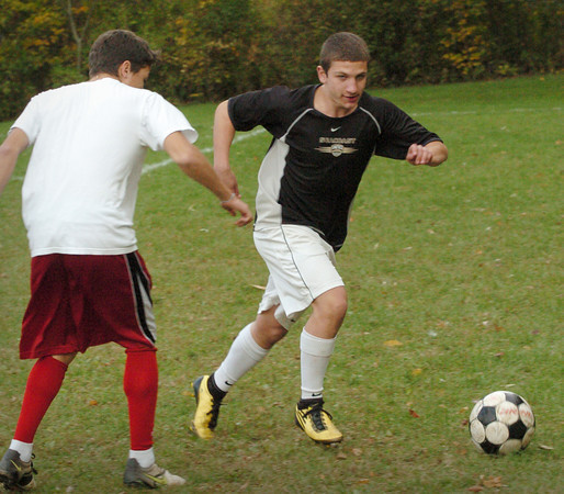 Amesbury:  Jason Wade, right, at practice with teammate Emilio Espinal. Bryan Eaton/Staff Photo