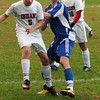 Amesbury: Amesbury's Alec Wade and Georgetown's number seven go after the ball in soccer action yesterday in Amesbury. Bryan Eaton/Staff Photo