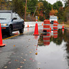 Newbury: One lane of traffic is open on Middle Road in Newbury on Friday morning despite portions of the road being covered with water. State and town crews dug drainage ditches on Thursday in anticpation of heavy rain which was feared could undermine the road caused by a beaver dam. Bryan Eaton/Staff Photo
