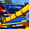 """Amesbury: Samuel Ruccio, 6, left, falls to the mat as Zachary Morin, 7, both of Amesbury, wins in a game of """"pedestal joust."""" That was one of the activities for children at the Amesbury Firefighters' Chili Cook-off on Saturday. Bryan Eaton/Staff Photo"""