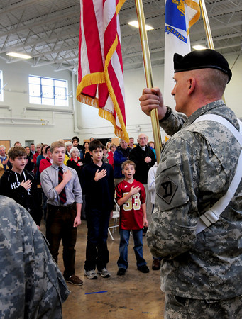 Newburyport: Newburyport school students say the Pledge of Allegiance as color guard Sgt. 1st Class Joseph Tuplin holds the flag during a ceremony  transferring ownership of the Newburyport Powder House from the state to the city of Newburyport. Bryan Eaton/Staff Photo