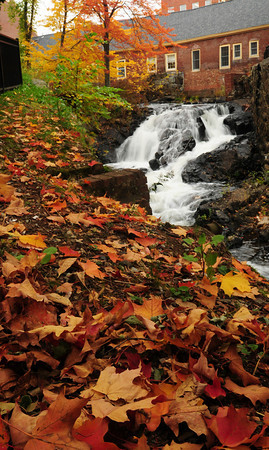 Amesbury: After being just a trickle all summer, the Powow River, shown in Amesbury's Upper Millyard, has a good flow as it passes fallen leaves. The weekend will certainly seem fall-like as temperatures will take a dip. Bryan Eaton/Staff Photo
