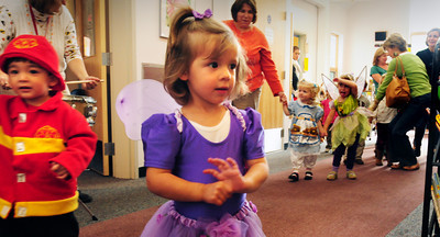 Byfield: Youngsters walk around the Newbury Public Library on Tuesday morning for a Halloween parade after story hour. They were read a couple scary books for children their age. Bryan Eaton/Staff Photo