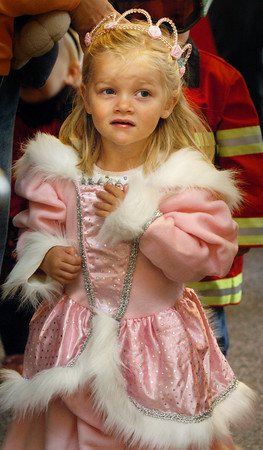 "Byfield: ""Princess"" Rebecca Hussey, 3, of Amesbury anxiously peeks out the door of the children's room at Newbury Public Library on Tuesday morning before the start of a Halloween Parade around the main area for adults to see. The children at the weekly story hour dressed up in their Halloween costumes for the readings. Bryan Eaton/Staff Photo"