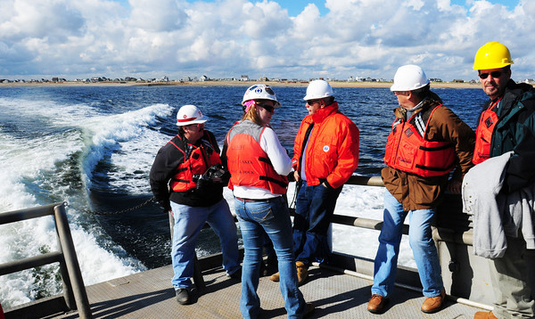 Newbury: Officials tour off the coast of Plum Island to see the replenished beaches there. Bryan Eaton/Staff Photo