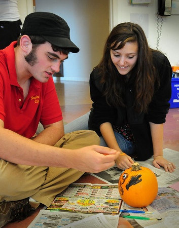 Newburyport: Newburyport High junior Michelle Fowler, 16, works with James Colburn as he paints a pumpkin in the Best Buddies Program. James was painting a likeness of Curly from the Three Stooges of which he's a big fan. Bryan Eaton/Staff Photo