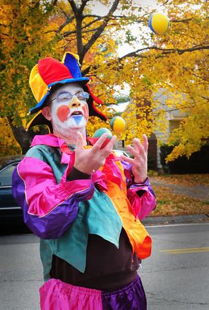 Amesbury: Amesbury Elementary School Principal Walter Helliesen juggles while walking in the school's Halloween Parade. Bryan Eaton/Staff Photo