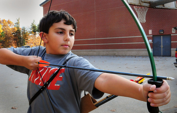 Salisbury: Nick Perreault, 10, takes aim for the archery target at Salisbury Elementary School. He was in the afterschool program Explorations, with the archery classes being taught by Jason Davis. Bryan Eaton/Staff Photo
