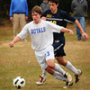 Georgetown: Georgetown's Chris Birnie moves the ball past a Lynnfield player. Bryan Eaton/Staff Photo