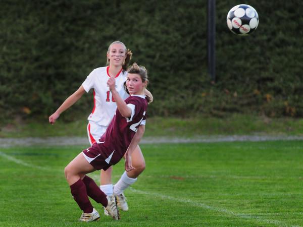Amesbury: Amesbury's Emily Martin kicks the ball downfield past Newburyport's Liza Twomey. Bryan Eaton/Staff Photo