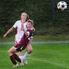 Amesbury: Amesbury's Emily Martin kicks the ball downfield past Newburyport's Liza Twomey. Bryan Eaton/Staff Photo