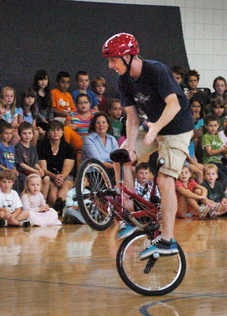 Salisbury: Chris Poulas does some fancy bike riding at Salisbury Elementary School on Thursday morning. In this enrichment program sponsored by the PTA, Poulas teaches children about anti-bullying and bicycle safety all the while keeping their attention with his bicycle stunts. Bryan Eaton/Staff Photo