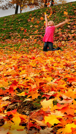 Newburyport: Kaylee Schlack throws leaves around at the Bartlet Mall as her mother, Staci, took some photos of her with the colorful foliage that has fallen from the rain. The five year-old from Salem was visiting Newburyport with her family Wednesday afternoon. Bryan Eaton/Staff Photo