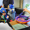 Amesbury: Children in Amesbury Recreation Department's Little Squirts Preschool Program made the rounds at town offices yesterday for some early trick-or-treating. Allison Heartquist hands out some candy in Mayor Kezer's office before they headed to the police department. Bryan Eaton/Staff Photo