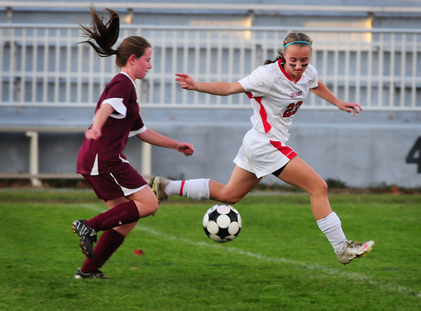 Amesbury: Amesbury's Megan Cullen moves ahead to try to stop a drive by Newburyport's Jackie Krusemark. Bryan Eaton/Staff Photo
