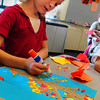 Newbury: Emma Houlihan, 7, attaches bits of color paper as she makes a collage of a maple tree with its colored leaves. She was Amy Merluzzi's art class at the Newbury Elementary School on Wednesday afternoon. Bryan Eaton/Staff Photo
