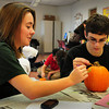 Newburyport: Newburyport High senior Alex Canning, 17, works with Mikey Nardone, 19, as they paint a pumpkin in the Best Buddies Program at the school. Bryan Eaton/Staff Photo