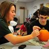Newburyport: Newburyport High senior Alex Canning, 17, works with Mikey Nardone, 19, as they paint a pumpkin in the Best Buddies Program at the school. Bryan Eaton/Staff Photo