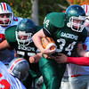 West Newbury: Amesbury's Ian McLaughlin grabs on to Pentucket's Jeremy Krugh to make the tackle. Bryan Eaton/Staff Photo