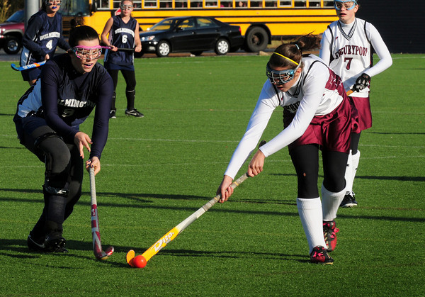 Amesbury: Newburyport's Cassandra Davis, right, moves on past a Wilmington player yesterday at the Amesbury Sports Park. Bryan Eaton/Staff Photo