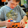 Amesbury: Owen Read, 8, makes a half positive and half negative jack-o-lantern in Karen Greenfield's art class  Wednesday morning. The Cashman School students were learning about different art techniques with a seasonal angle. Bryan Eaton/Staff Photo