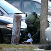 Newburyport: A State Police Bomb Squad technician empties the contents of a suspicious package found in the Green Street parking lot in Newburyport Monday afternoon. Photo by Ben Laing/Staff Photo