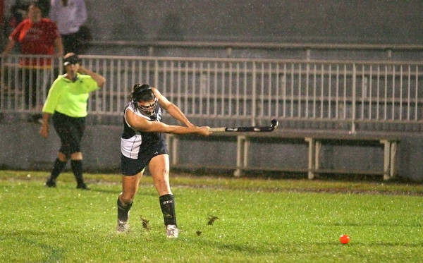 Amesbury: Triton's Erin Curley (12) takes a shot in a steady rain at Landry Stadium in Amesbury Wednesday night, as the Vikings and Indians played to a 0-0 draw. Photo by Ben Laing/Staff Photo