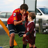 Newburyport: Mitchell Casson, 5, of Newburyport, gets a high five from Newburyport High School soccer player Zaid Eideh during a clinic at Cashman Park. The high school players spent the afternoon playing games and doing drills with the Newburyport youth soccer players. Photo by Ben Laing/Staff Photo