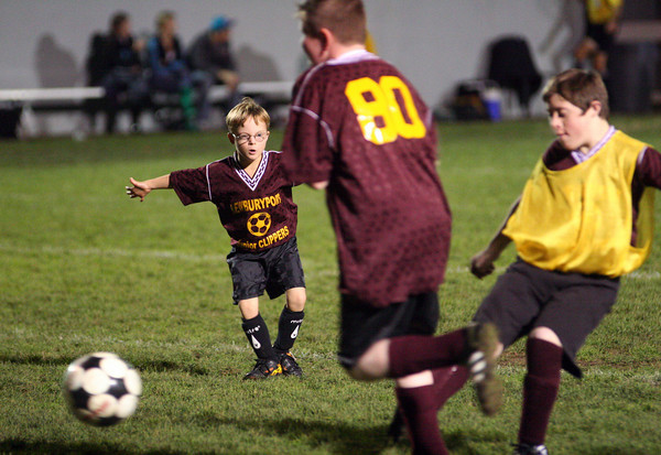 Newburyport: Ben St. Lawrence, 8, of Newburyport, rushes up the field to play defense during the Newburyport Junior Clippers soccer game at halftime of the boys varsity game Wednesday night. Photo by Ben Laing/Staff Photo