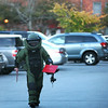 Newburyport: A member of the State Police Bomb Squad unit returns to his vehicle with xrays of a suspicious package in the Green Street parking lot in downtown Newburyport Monday afternoon. Photo by Ben Laing/Staff Photo