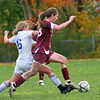 Georgetown: Newburyport's Sara Casey (18) slips past Georgetown's Ashley Mueskes (6) during Monday afternoon's game. Photo by Ben Laing/Staff Photo