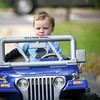 Amesbury: Nate O'Donnell, 3, of Amesbury, takes a spin in his toy Jeep while on a walk with his mom down Main Street Monday morning. Photo by Ben Laing/Staff Photo