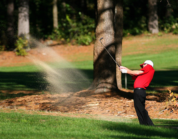 Rowley: Amesbury's Jonathan Fournier chips out of a sand trap during Wednesday's River Rival golf tournament in Rowley. Photo by Ben Laing/Staff Photo