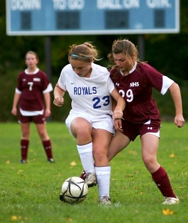 Georgetown: Georgetown's Taylor Nelson (23) tries to turn on Newburyport's Liza Twomey (29) during Monday's game in Georgetown. Photo by Ben Laing/Staff Photo