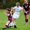 Georgetown: Newburyport's Sara Casey (18) slides in on Georgetown's Ashley Mueskes (6) during Monday afternoon's game in Georgetown. Photo by Ben Laing/Staff Photo