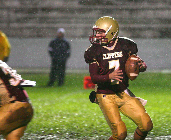 Newburyport: Clipper quarterback Ryan O'Connor (7) drops back to pass during Friday night's game against Wilmington. Photo by Ben Laing/Staff Photo