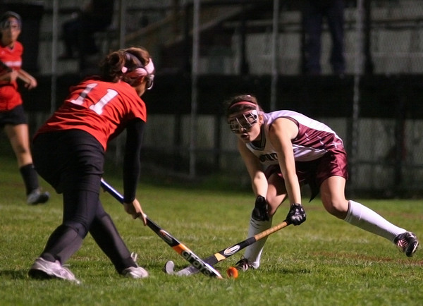 Newburyport: Paige Hefferan (7) of Newburyport pokes a ball away from a North Andover player during Wednesday night's game. Photo by Ben Laing/Staff Photo