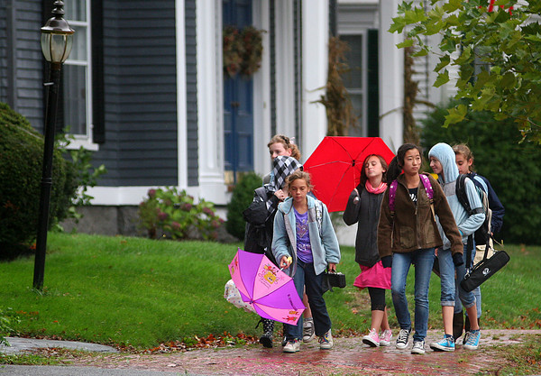 Newburyport: A group of middle schoolers walk home in the rain down High Street Wednesday afternoon, despite the wind and rain. Photo by Ben Laing/Staff Photo