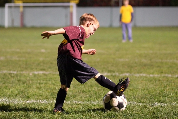 Newburyport: Ben St. Lawrence, 8, of Newburyport, takes a shot on goal during the Newburyport Junior Clippers soccer game at halftime of the boys varsity game Wednesday night. Photo by Ben Laing/Staff Photo