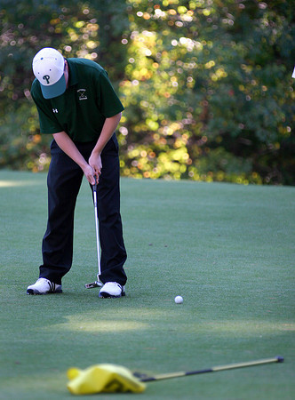 Rowley: Jason Steele of Pentucket taps his ball toward the hole during Wednesday's River Rival golf tournament in Rowley. Photo by Ben Laing/Staff Photo