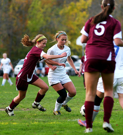 Georgetown: Georgetown's Nikki Holland (17) can't shake Newburyport defender, Carly Brand (11), during Monday afternoon's game. Photo by Ben Laing/Staff Photo