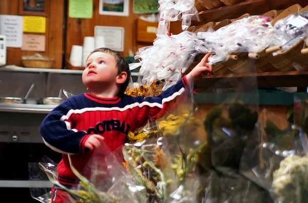 Newbury: Cillian Harty, 3, of Amesbury, asks his mom for some candy while they shop at Tendercrop Farm in Newbury Wednesday afternoon. Photo by Ben Laing/Staff Photo