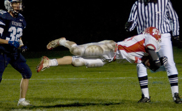 Byfield:  Masco's Dylan Mann dives over the goal line  during their game at Triton Friday night. JIm Vaiknoras/Staff photo