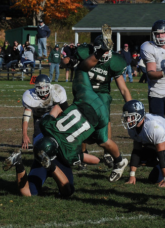 West Newbury: Pentucket's Mike Doud is upended during the Sachem's game against  Wilmington in West Newbury Saturday. Jim Vaiknoras/Staff photo