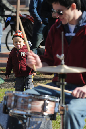 Newburyport: Gerig Wittner ,2,  checks out the drumming by PJ Holaday as he performs with the band Metaphysics  at the Rally to Restore Sanity in Brown Square in Newburyport Saturday. Jim Vaiknoras/Staff photo