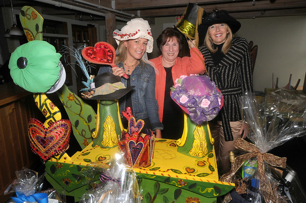Newburyport:  Organizers of The Actor's Studio in The Tannery's first Halloween costume ball and auction, Fran Walker, Jeanette Isabella and Elizabeth Boussu pose with some of teh auction items. JIm Vaiknoras/Staff photo