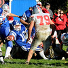 Georetown: Georgetown's Tyler Wade fights for yardage during the Royal's home game against Amesbury Saturday. Jim Vaiknoras/STaff photo